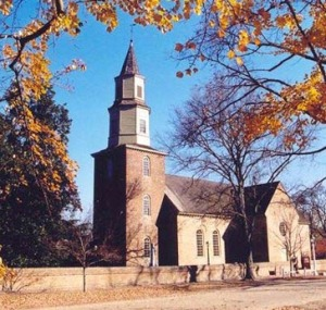Historic Bruton Parish Episcopal Church in Colonial Williamsburg, Virginia.  What mysteries of the Mayan calendar supposedly lie beneath the courtyard?