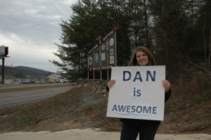 "In verse 23, a ""Proverbs 31"" woman is described as someone whose husband ""is respected at the city gates"". Here, blogger and author Rachel Held Evans praises her husband ""Dan"" at the Dayton, Tennesse welcome sign."