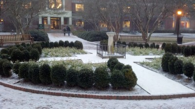 Snow falling on the sundial, in front of Swem Library on the campus of William and Mary, early evening, January 28, 2014.