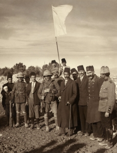 Turkish major (FINALLY) surrenders Jerusalem to British troops in World War One, using a sheet from the Spafford American Colony as a surrender flag.