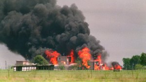 Flames erupt form the Branch Davidian compound in Waco, Texas after a raid led by the Bureau of Alcohol, Tobacco, and Firearms, on April 20, 1993.